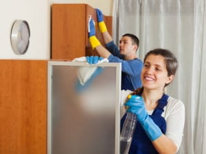 26110430 - professional cleaners team working at living room